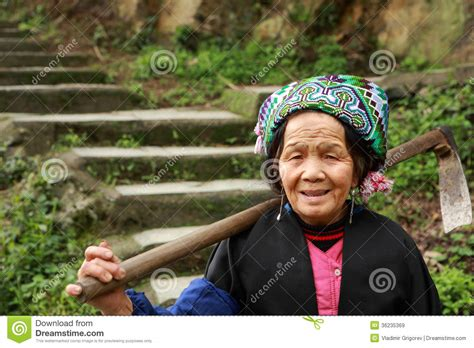 Asian Elderly Chinese Woman Farmer Peasant With Hoe On