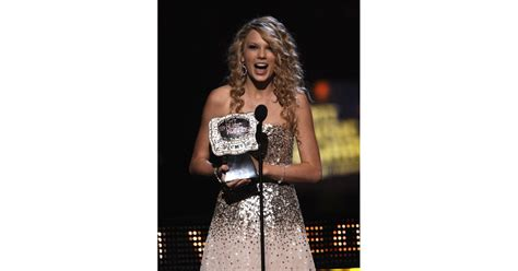 Taylor showed her shock while accepting a CMT award in ...
