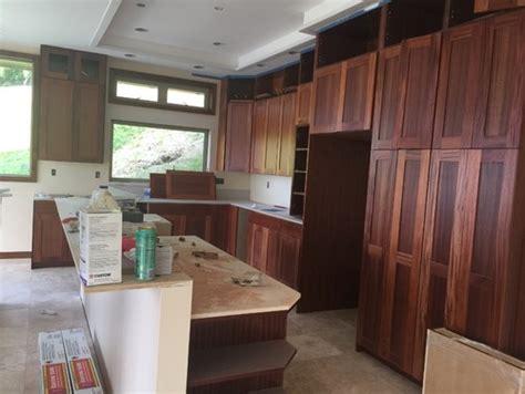 kitchen cabinet decor backsplash for taj mahal countertop and mahogany cabinets 6688