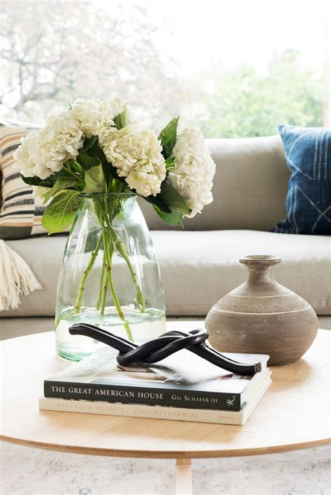 Round wood coffee table brings casual elegance to your living room. New, new, new! Fresh Decor for your home. - Studio McGee   Round coffee table decor, Round ...