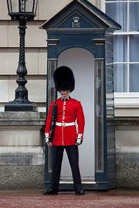 Grenadier Guard at Buckingham Palace, London, UK. # ...