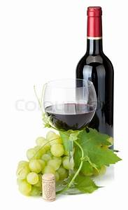 Red wine glass, bottle and grapes | Stock Photo | Colourbox