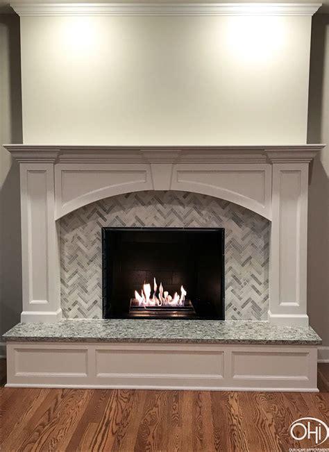 fireplace  wood panels herringbone tile