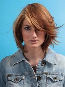 Mid-length layered haircut with interior layers to create soft bulk  Medium