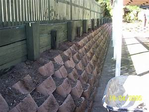 Installing concrete retaining wall block garden inspiration for Building a garden wall with concrete blocks