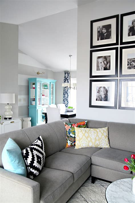 this color scheme for the living room navy blue pop of yellow gray walls