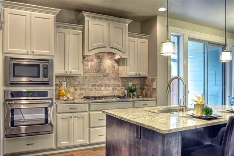 sherwin williams snowbound painted cabinets make the kitchen feel bigger and painting