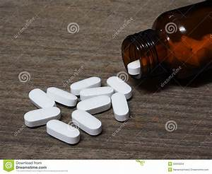 Pills Spilling Out Of Pill Bottle Stock Photo ...