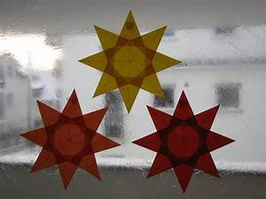 Sterne Aus Papier Schneiden : rot orange gelber stern 8 zacken sterne aus transparentpapier basteln ~ Watch28wear.com Haus und Dekorationen