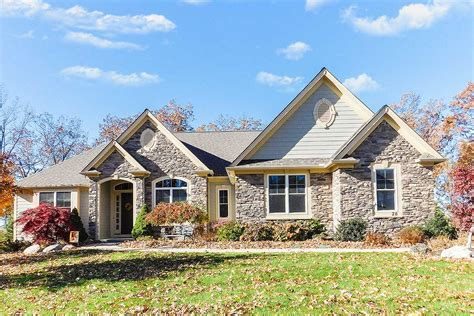 lovely ranch house plan  stone accents ced architectural designs house plans