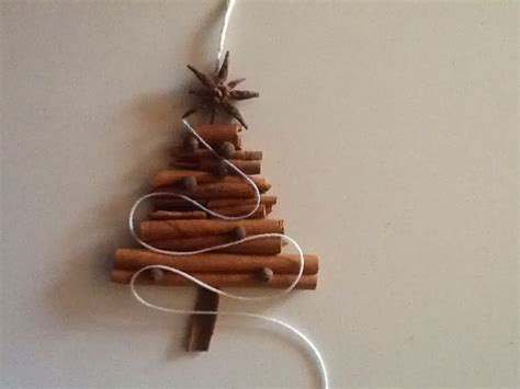 a whimsical cottage cinnamon stick ornament