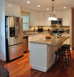kitchen remodeling island kitchen remodel white cabinets tile backsplash undercabinet lighting island traditional
