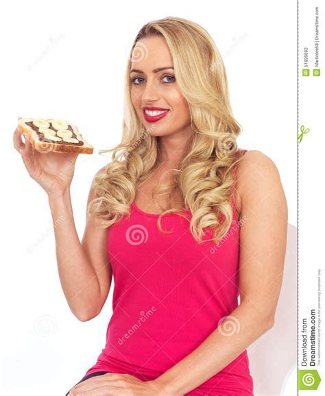 Young Woman Eating Toast With Chocolate Spread And Banana