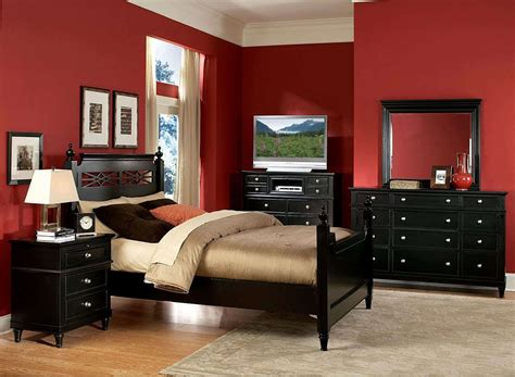 bedroom with black furniture and red walls bold red