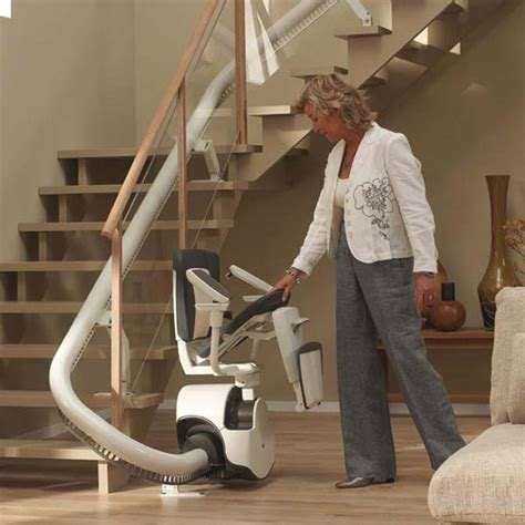 modern curved indoor stair lift design from thyssenkrupp