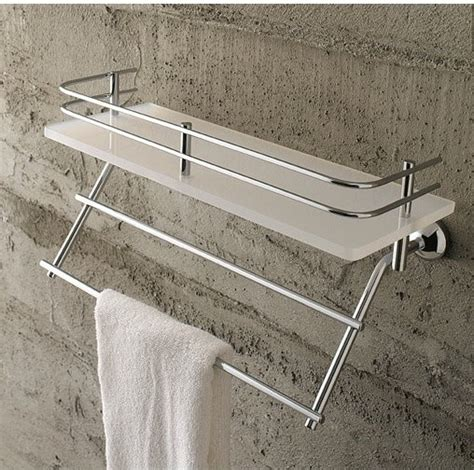 frosted glass shelf with railing and towel bar