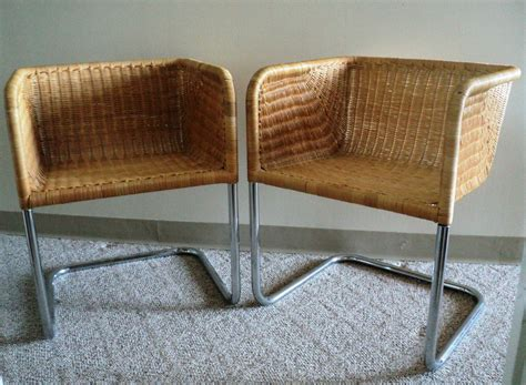 pair of chrome and wicker chairs by fabricius kastholm