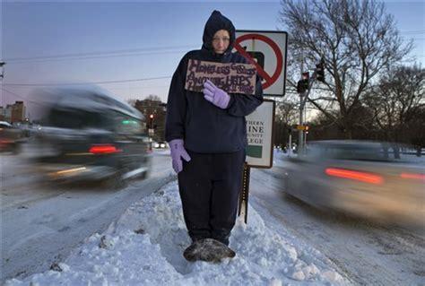 homeless man helps push cars  hill  snow storm