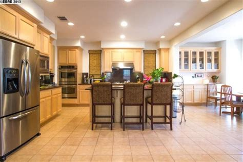 Help us tone down natural oak color of cabinets by