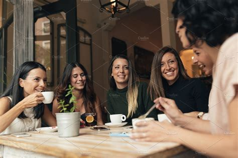 First is its aroma, especially the freshly brewed up coffee. women drinking coffee in cafe bar. ~ People Photos ~ Creative Market
