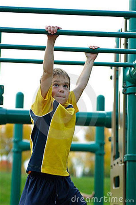 boy  monkey bars stock  image