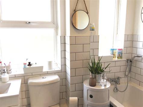 white bathroom  white metro tiles  grey grout