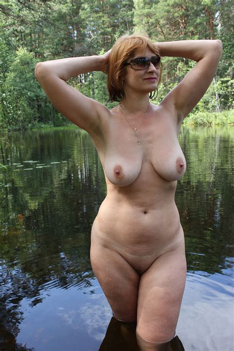 Russian mature wife with big boobs posing outdoors ...