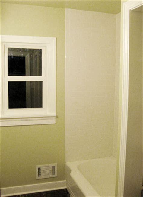 bathroom renovation   install baseboards trim