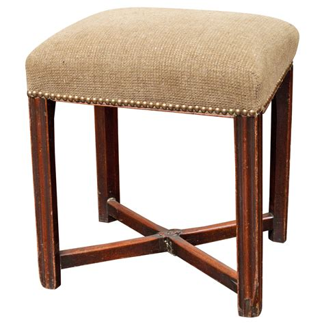 pair of carved and upholstered mahogany wing george iii upholstered mahogany stool circa 1780