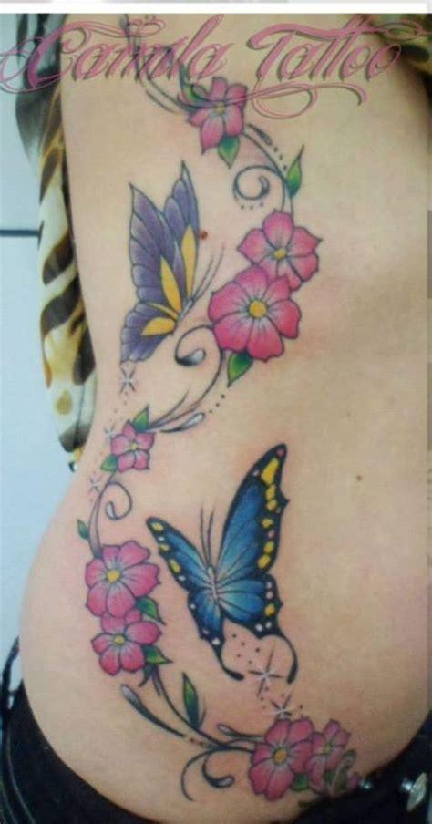 Tatuagem Feminina de ramo de flor com borboletas desenho
