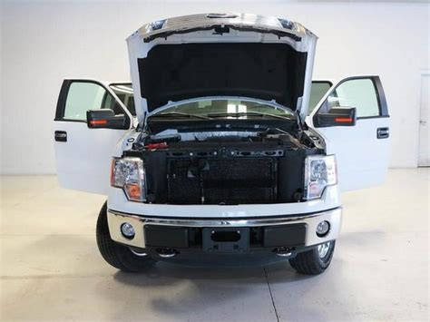 2012 Ford F-150 Truck Doors Open Hood Up Front View