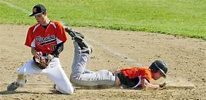Winslow first baseman Jon Nerney hangs on to the ball, but ...