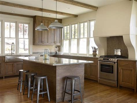 Swap them for a dark or black hardware to compliment your backsplash. Stained Oak Kitchen Cabinets with Gray Granite Countertops ...