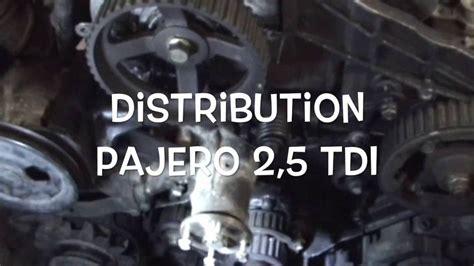 Courroie distribution Pajero - YouTube