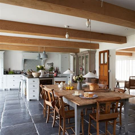 homes interiors uk farmhouse style kitchen diner with large wooden dining