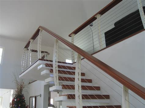 White Interior Cable Railing On Cantilever Stairs