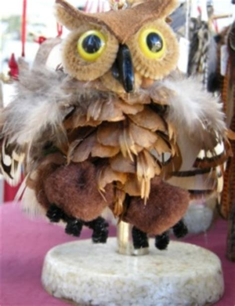 owl creations from pine cones and fluff pine cone crafts using conifer cones and seed pods for rustic crafts