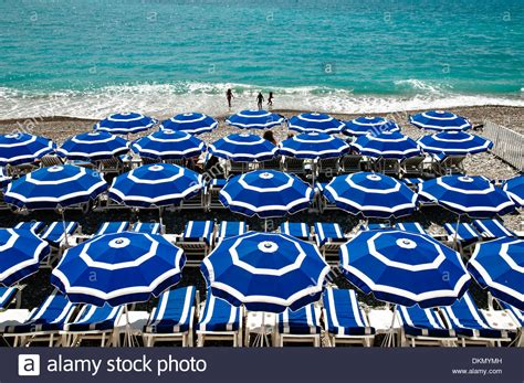 Beach In Nice Blue Umbrellas And The Azure Sea French