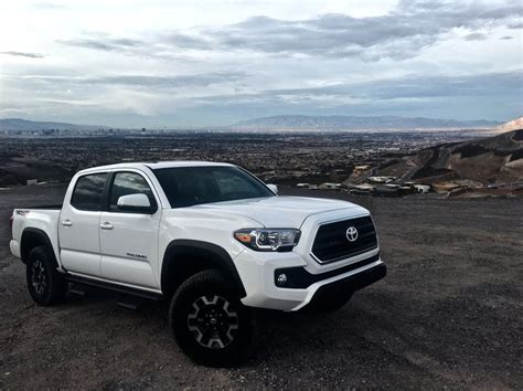 Blacked Out Grill With Chrome Border And Toyota Logo