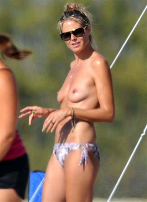 Heidi Klum Topless Sunbathing On Beach In Corsica