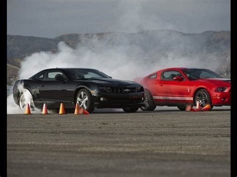 shelby gt crushes camaro ss drag race showdown