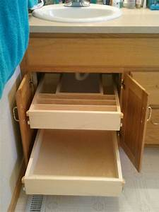 Bathroom cabinet storage solutions under cabinet roll out for Bathroom cupboard storage solutions