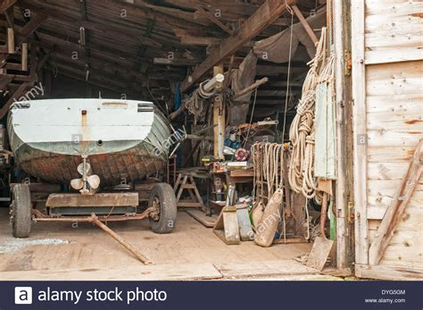 Old Boat Equipment by Interior View Of An Old Boat Yard Workshop Showing A