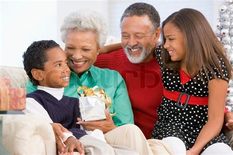 black grandparents an african american grandparents with their grandchildren celebrating christmas day stock