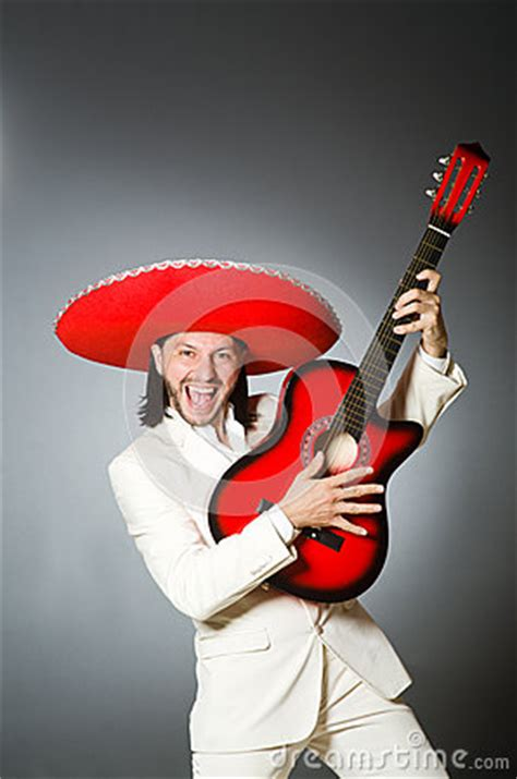young mexican guitar player wearing sombrero stock photo