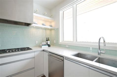 white kitchen with glass tile backsplash 71 exciting kitchen backsplash trends to inspire you 2104