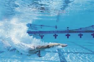Female swimmer underwater — Image by © Ocean/Corbis Swimmer's Ear