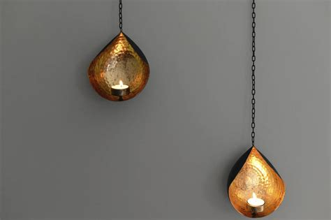 hanging gold and black tea light holder by the forest co