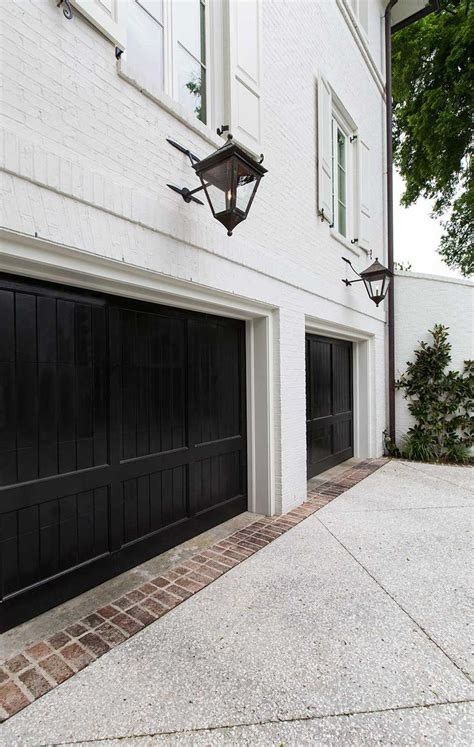 White Garage Doors by Black Trim Is The Decorating Accent