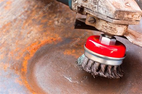 wire brush  cleaning rust  metal surface stock